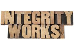 Integrity works in wood type Stock Photos