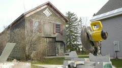 Old wooden barn with powersaw Stock Footage