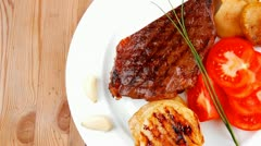 Meat savory : grilled beef fillet mignon with tomato Stock Footage