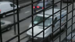 London roads behind cage Stock Footage