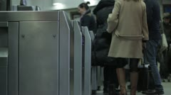 People going through ticket barriers 3 Stock Footage