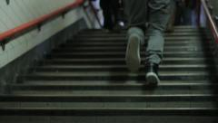 Stock Video Footage of people walk up stairs from underground
