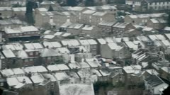Rooftops with snow pan to trees Stock Footage