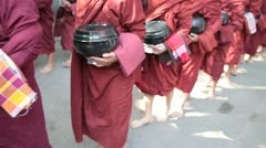 Young Buddhist Monks in Myanmar (Burma) Parading with Food - stock footage