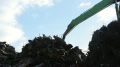 Crane working with metal scrap Stock Footage