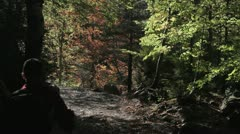 Young couple hiking in a forest Stock Footage