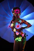 Woman with luminescent body art Stock Photos