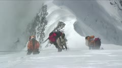 Sherpas and Climbers in heavy winds Stock Footage
