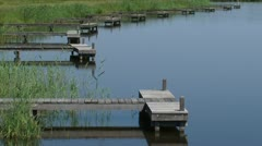 Wooden piers in lake Oldambtmeer - zoom out Urban Development Project Stock Footage