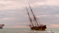 Two masted rigger hard aground Stock Footage