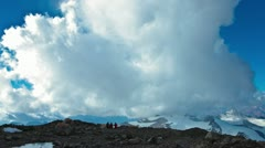 Aconcagua Time lapse - racing clouds at camp with climbers Stock Footage