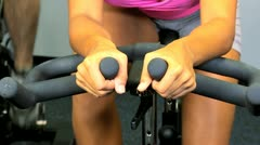 Female Using Health Club Exercise Bike Hands Legs Stock Footage