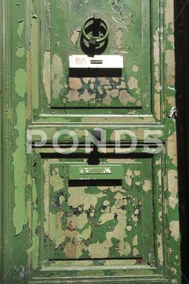 Stock photo of Grungy green door