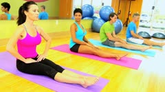 Fitness Class Enjoying Floor Exercises - stock footage