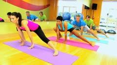 Fitness Class Enjoying Floor Exercises Stock Footage