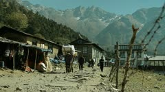 Porters walking down trail in Lukla Stock Footage