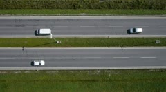 Aerial shot of highway traffic and railroad - stock footage