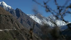 Glide revealing Dingboche stupa, Everest & Lhotse Stock Footage