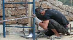Roofing work - welding piles Stock Footage