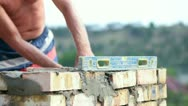 Bricklayer at work Stock Footage