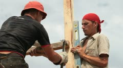 Roofers working on a construction site Stock Footage