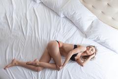 Slender brunette posing in lingerie Stock Photos