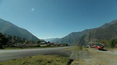 Helicopter beside runway at Lukla, plane takes off Stock Footage