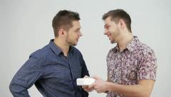 One brother to another gives a gift Stock Footage