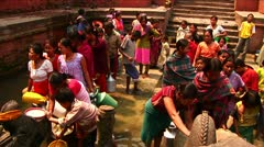 Women waiting to fill up water at community taps Stock Footage