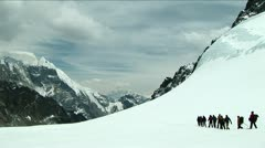 Climbers walking across snowy plateau Stock Footage