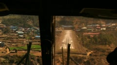 Cockpit view of plane landing at Lukla Stock Footage