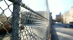 Fence with sun flaring through - stock footage