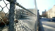 Stock Video Footage of Fence with sun flaring through