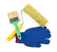 tool kit: paint roller, paint brush, work gloves - stock photo
