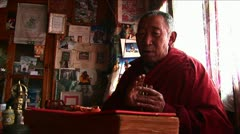 Lama chanting prayer in temple - stock footage