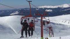 People Riding with Chairlift in Alps, Alpine View, Winter Sports, Skiing Slope - stock footage