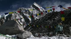 Puja alter with prayer flags and mountain behind - stock footage