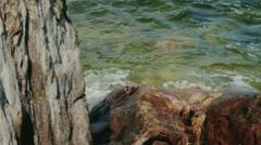 Green Sea Water Splashing Brown Coast Rock Glistening - 25FPS PAL Stock Footage