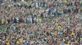 Football fans celebrate a goal. Unrecognizable crowd of people watching soccer HD Footage