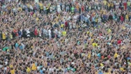 Football fans celebrate a goal. Unrecognizable crowd of people watching soccer Stock Footage