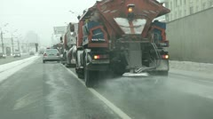 MOSCOW - MAR 24, 2013: Truck scatters chemicals for melting snow on roads. Stock Footage