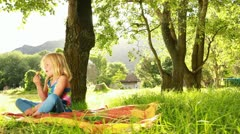 Girl is eating delicious Ice Cream in the park. Stock Footage