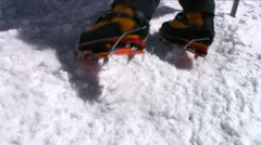 Crampons digging into snow as climber ascends Stock Footage