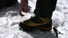 Stock Video Footage of Putting crampons on boots