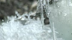 Water dripping off icicles, water rushing by - stock footage