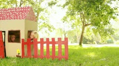 Video of happy little children sitting in playhouse. Stock Footage