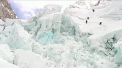 Climbers dwarfed by ice formations Stock Footage