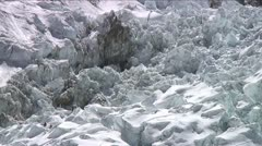 Climbers in icefall looking small Stock Footage