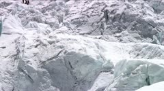 Pan up with climbers in Khumbu icefall - stock footage