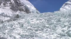 Pan of icefall with climbers Stock Footage